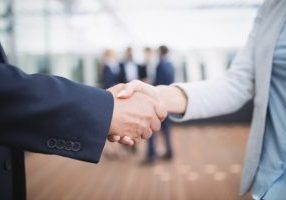 businesspeople-shaking-hands_107420-84876